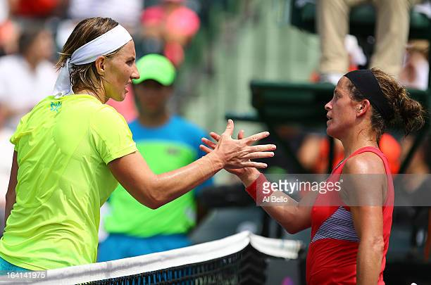 Svetlana Kuznetsova of Russiashakes hands with Lourdes Dominguez Lino of Spain after her win during Day 3 of the Sony Open at at the Crandon Park...