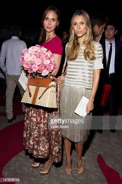 Svetlana Metkina and Aleksandra Melnichenko attend the Ulyana Sergeenko HauteCouture Show as part of Paris Fashion Week Fall / Winter 2013 at Theatre...