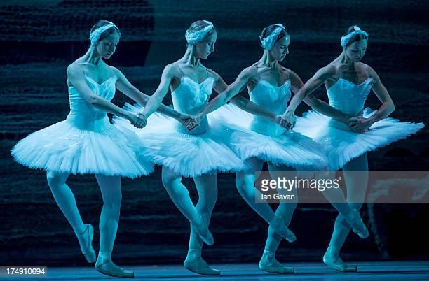 Svetlana Pavlova Mararita Shrainer Yulia Lunkina and Anna Voronkova of the Bolshoi Ballet perform during a photocall for 'Swan Lake' at The Royal...