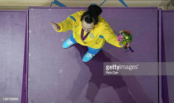 Svetlana Podobedova of Kazakhstan celebrates on the podium with her Gold medal following the Women's 75kg Weightlifting Final on Day 7 of the London...