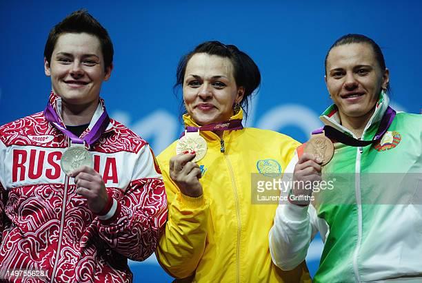 Svetlana Podobedova of Kazakhstan celebrates on the podium with her Gold medal Natalya Zabolotnaya of Russia the Silver and Iryna Kulesha of Belarus...