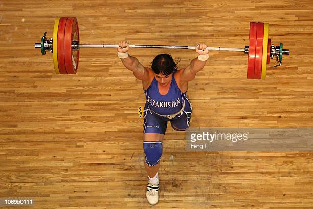 Svetlana Podobedova of Kazakhstan competes in the weightlifting Women's 75 kg Group A during day six of the 16th Asian Games Guangzhou 2010 at...