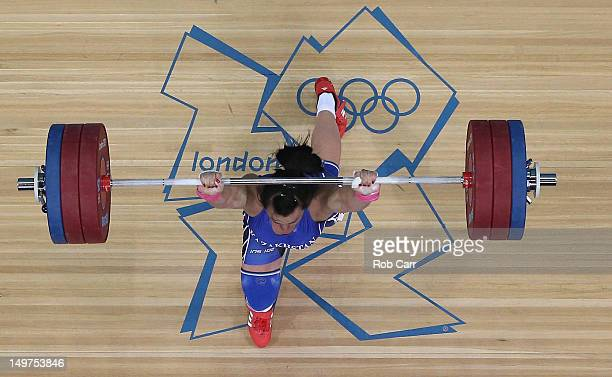 Svetlana Podobedova of Kazakhstan competes on her way to winning Gold during the Women's 75kg Weightlifting Final on Day 7 of the London 2012 Olympic...