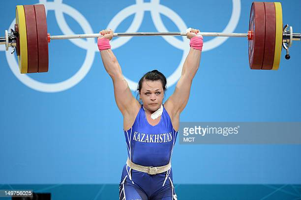 Svetlana Podobedova of Kazakhstan makes her gold medal winning lift in the women's 75kg weightlifting competition the ExCeL centre during the 2012...