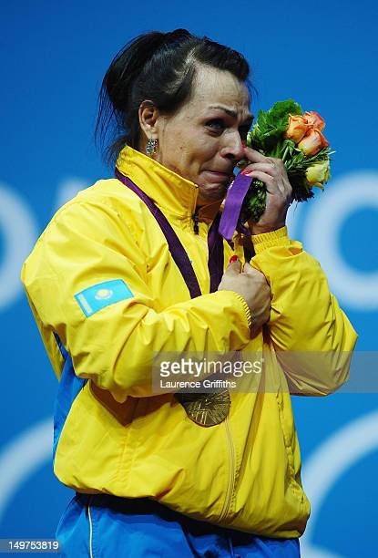 Svetlana Podobedova of Kazakhstan reacts on the podium after receiving her Gold medal following the Women's 75kg Weightlifting Final on Day 7 of the...