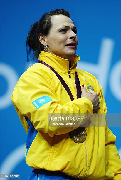 Svetlana Podobedova of Kazakhstan stands on the podium for her national anthem after receiving her Gold medal following the Women's 75kg...