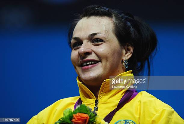 Svetlana Podobedova of Kazakhstan stands on the podium with her Gold medal following the Women's 75kg Weightlifting Final on Day 7 of the London 2012...