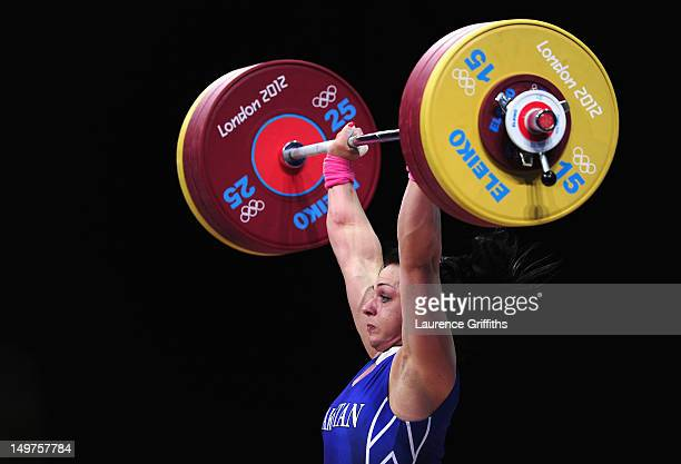 Svetlana Podobedova of Kazakhstanc ompetes on her way to winning Gold during the Women's 75kg Weightlifting Final on Day 7 of the London 2012 Olympic...