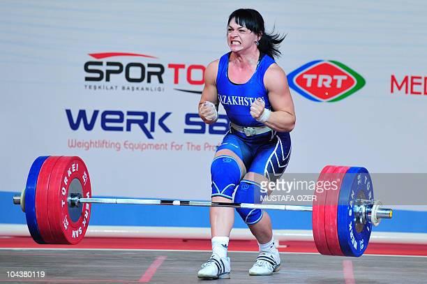 Svetlana Podobedova of Kazhakstan celebrates after her world record in the women's 75kg weightlifting competition at the World Weightlifting...
