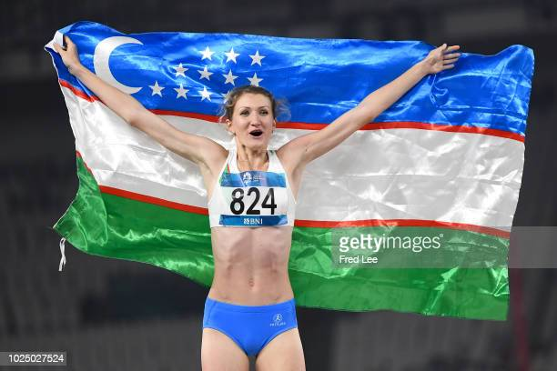 Svetlana Radzivil of Uzbekistan celebrates after the final of the women's high jump athletics event during on day eleven of the Asian Games on August...