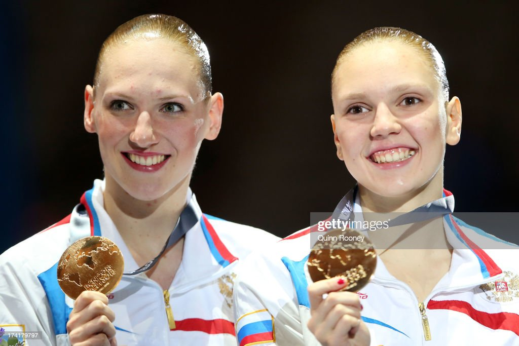 Svetlana Romashina and Svetlana Kolesnichenko of Russia pose with their gold medals after winning the Synchronized Swimming Duet Technical final on day two of the 15th FINA World Championships at Palau Sant Jordi on July 21, 2013 in Barcelona, Spain.