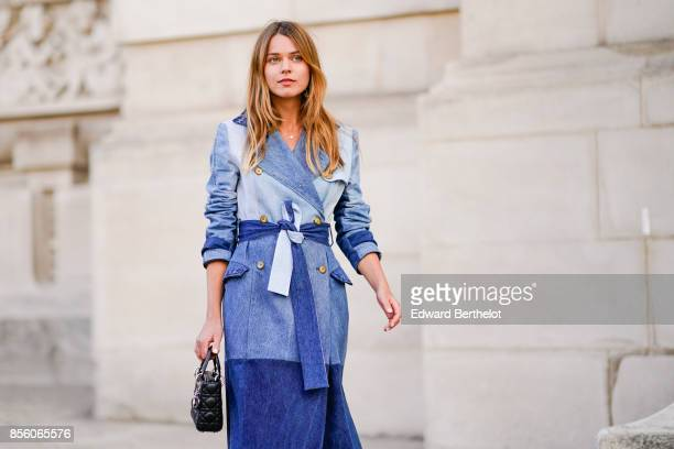 Svetlana Shashkova wears a blue denim dress outside Elie Saab during Paris Fashion Week Womenswear Spring/Summer 2018 on September 30 2017 in Paris...