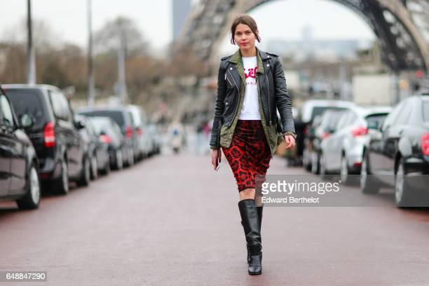 Svetlana Shashkova wears a vintage khaki jacket a Michael kors black leather perfecto jacket a Gaelle Paris white shirt with red printed logo a...