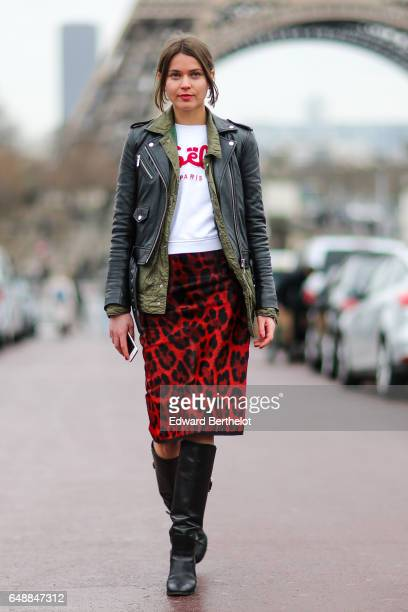 Svetlana Shashkova wears a vintage khaki jacket a Michael kors black leather perfecto jacket a Gaelle Paris white shirt with red printed logo a...