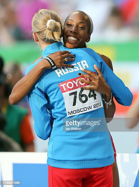 Svetlana Shkolina of Russia hugs Brigetta Barrett of the United States in the Women's High Jump final during Day Eight of the 14th IAAF World...