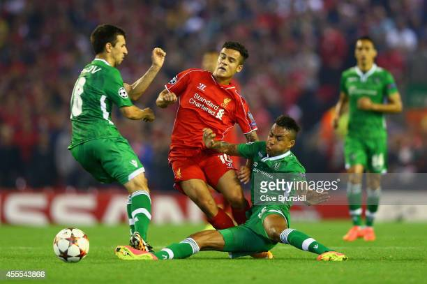 Svetoslav Dyakov and Razgrad Anicet Abel of PFC Ludogorets Razgrad tackle Philippe Coutinho of Liverpool during the UEFA Champions League Group B...
