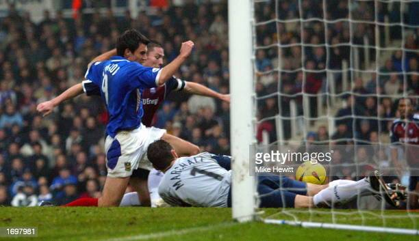 Svetoslav Todorov of Portsmouth forces the ball home past Andy Marshall of Ipswich during the Nationwide League Division One match between Portsmouth...