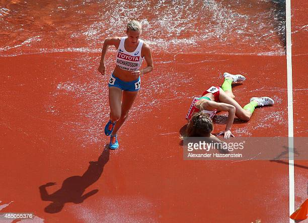 Sviatlana Kudzelich of Belarus falls in the Women's 3000 metres steeplechase heats during day three of the 15th IAAF World Athletics Championships...