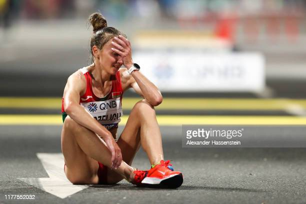 Sviatlana Kudzelich of Belarus reacts after finshing the Women's Marathon during day one of 17th IAAF World Athletics Championships Doha 2019 at...