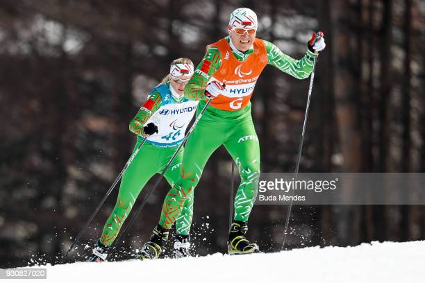 Sviatlana Sakhanenka and her guide Raman Yashchanka of Belarus compete in the Women's 15km Free Visually Impaired Cross Country event at Alpensia...
