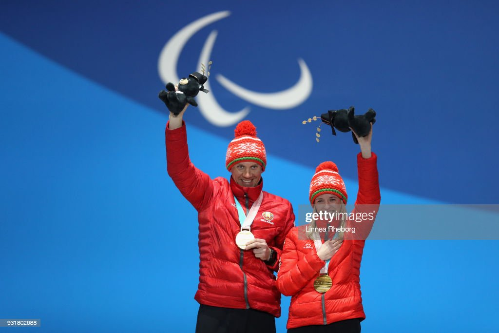 Sviatlana Sakhanenka of Belarus (R) and her guide Raman Yashchanka celebrates during the medal ceremony for Women's 1.5km Sprint Classic, Visually Impaired during day five of the PyeongChang 2018 Paralympic Games on March 14, 2018 in Pyeongchang-gun, South Korea.