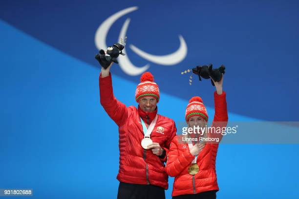 Sviatlana Sakhanenka of Belarus and her guide Raman Yashchanka celebrates during the medal ceremony for Women's 15km Sprint Classic Visually Impaired...