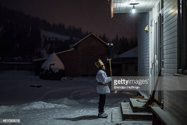 Sviatoslav Mahulia sings in front of a house while going door to door caroling in celebration of Orthodox Christmas on January 6 2015 in Iltsi...