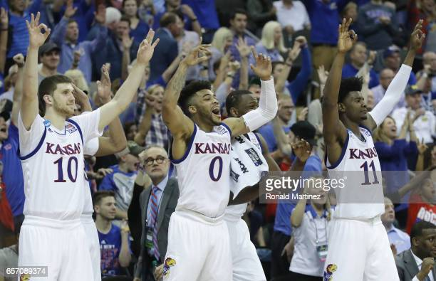 Sviatoslav Mykhailiuk Frank Mason III Dwight Coleby and Josh Jackson of the Kansas Jayhawks celebrate defeating the Purdue Boilermakers 9866 during...