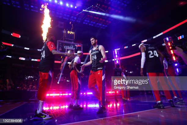 Sviatoslav Mykhailiuk of the Detroit Pistons and his teammates wear 8 and 24 jerseys during introductions to honor former Los Angeles Laker Kobe...