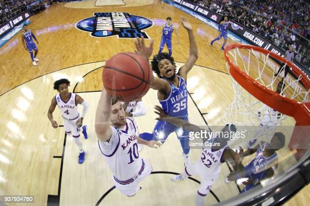 Sviatoslav Mykhailiuk of the Kansas Jayhawks and Marvin Bagley III of the Duke Blue Devils battle for the ball in the 2018 NCAA Men's Basketball...