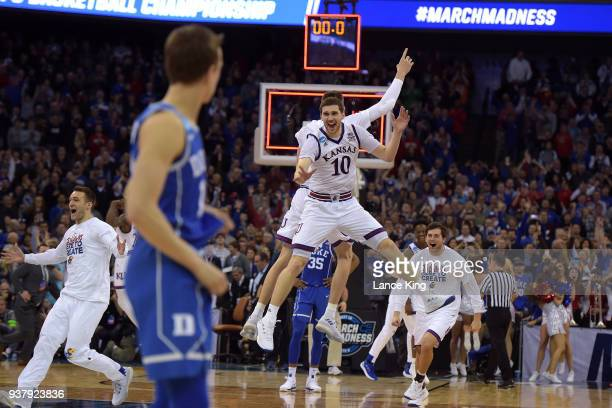 Sviatoslav Mykhailiuk of the Kansas Jayhawks celebrates with teammates following their 8581 OT win against the Duke Blue Devils during the 2018 NCAA...