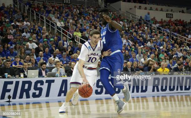 Sviatoslav Mykhailiuk of the Kansas Jayhawks drives against Ismael Sanogo of the Seton Hall Pirates in the first half during the second round of the...