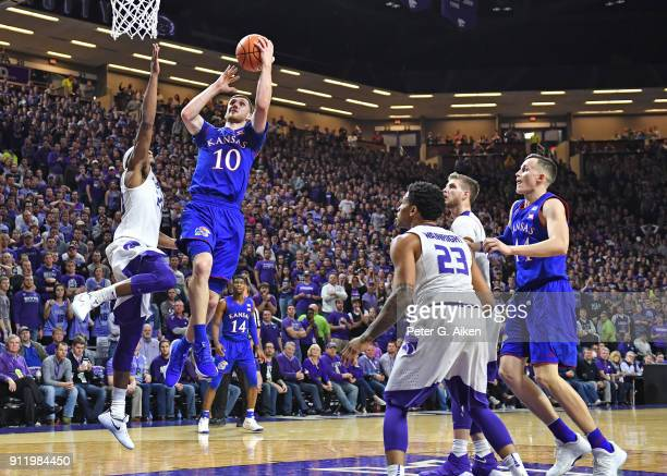 Sviatoslav Mykhailiuk of the Kansas Jayhawks drives to the basket against Xavier Sneed of the Kansas State Wildcats during the first half on January...