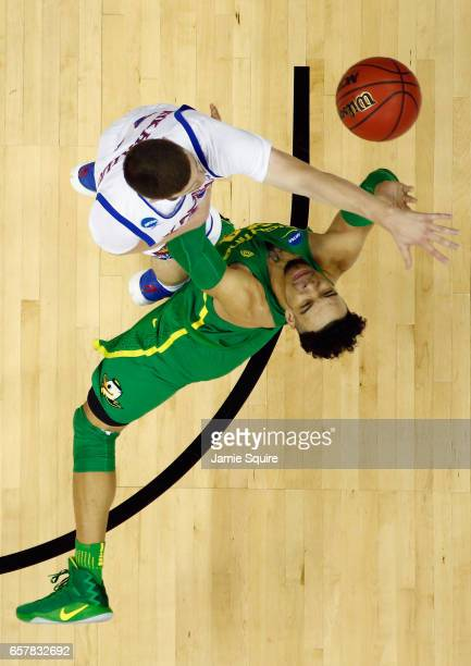 Sviatoslav Mykhailiuk of the Kansas Jayhawks fouls Dillon Brooks of the Oregon Ducks in the first half during the 2017 NCAA Men's Basketball...