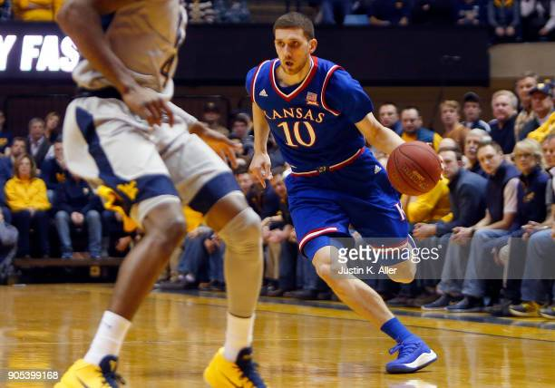 Sviatoslav Mykhailiuk of the Kansas Jayhawks handles the ball against the West Virginia Mountaineers at the WVU Coliseum on January 15 2018 in...