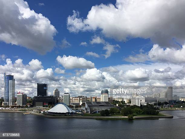 svisloch river by cityscape against sky - minsk stock pictures, royalty-free photos & images