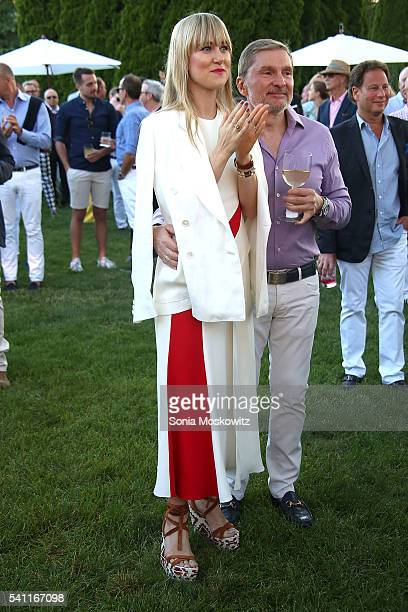 Svitlana Flom and Gary Flom attend Midsummer Night Drinks to benefit God's Love We Deliver