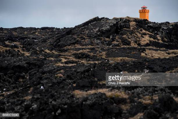 Svrtuloft lighthouse juts out of black vocanic rock on the coast of Snaefellsnes Peninsula in the Snaefellsjokull National Park on March 27 2017 at...