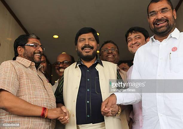 Swabhimani Shetkari Sanghatana leader Raju Shetty and RPI president Ramdas Athawale during a meeting at Rang Sharda Hotel Bandra on September 17 2014...