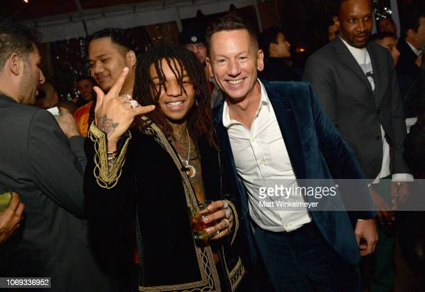 Swae Lee and EditorInChief of GQ Jim Nelson attend the 2018 GQ Men of the Year Party at a private residence on December 6 2018 in Beverly Hills...