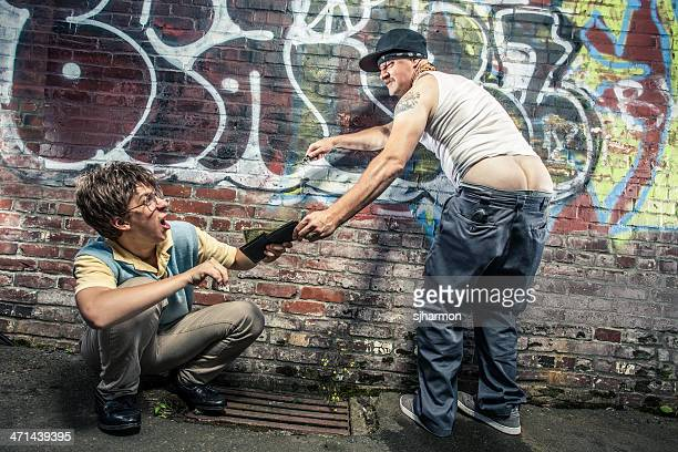 swagger sagging pants gangster man muggs scared teenager for money - mooning stock photos and pictures