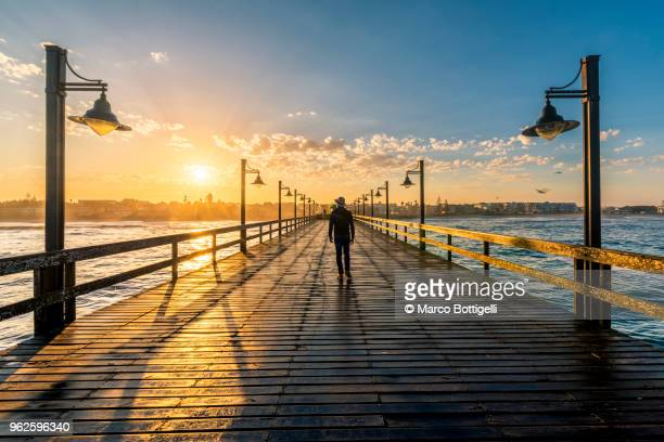 swakopmund pier at sunrise - vanishing point stock pictures, royalty-free photos & images