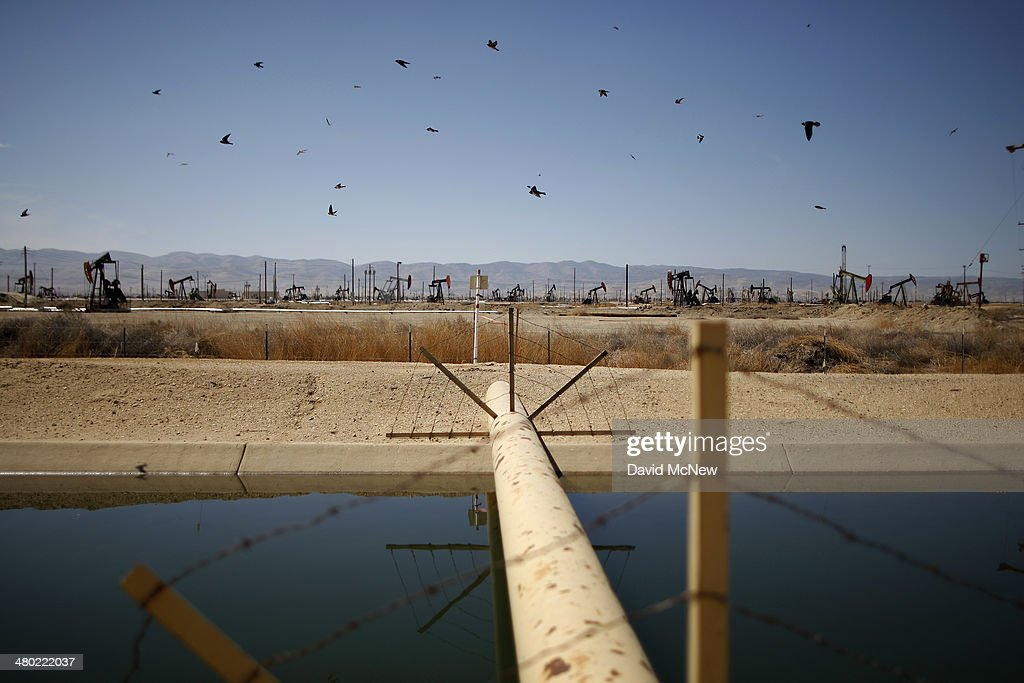 Swallows fly past a high pressure gas line crossing a canal in an oil field over the Monterey Shale formation where gas and oil extraction using hydraulic fracturing, or fracking, is on the verge of a boom on March 23, 2014 near Lost Hills, California. Critics of fracking in California cite concerns over water usage and possible chemical pollution of ground water sources as California farmers are forced to leave unprecedented expanses of fields fallow in one of the worst droughts in California history. Concerns also include the possibility of earthquakes triggered by the fracking process which injects water, sand and various chemicals under high pressure into the ground to break the rock to release oil and gas for extraction though a well. The 800-mile-long San Andreas Fault runs north and south on the western side of the Monterey Formation in the Central Valley and is thought to be the most dangerous fault in the nation. Proponents of the fracking boom saying that the expansion of petroleum extraction is good for the economy and security by developing more domestic energy sources and increasing gas and oil exports.
