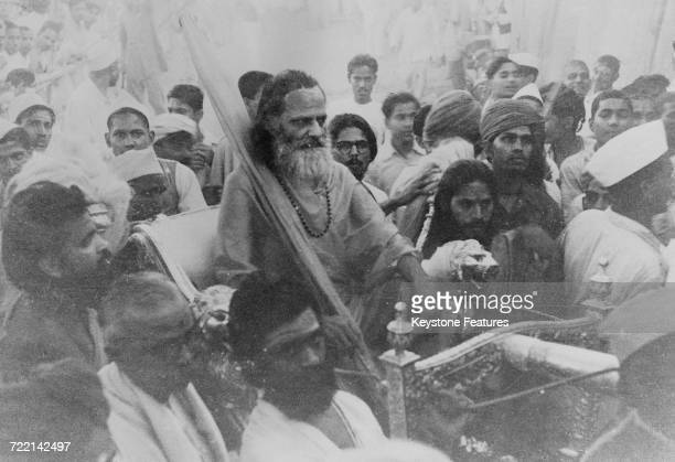 Swami Brahmananda Saraswati the Shankaracharya of the Jyotir Math monastery arrives on a golden palanquin at a Hindu ceremony of prayer for world...