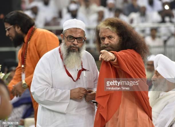 Swami Chidanand Saraswati talking to Jamiat UlemaeHind general secretary Maulana Mahmood Madani during the peace unity conference Aman and Ekta...