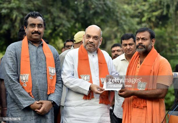 Swami Paripoornananda a seer from Sree Peetham in Andhra Pradesh joined the Bharatiya Janata Party in the presence of its president Amit Shah and...
