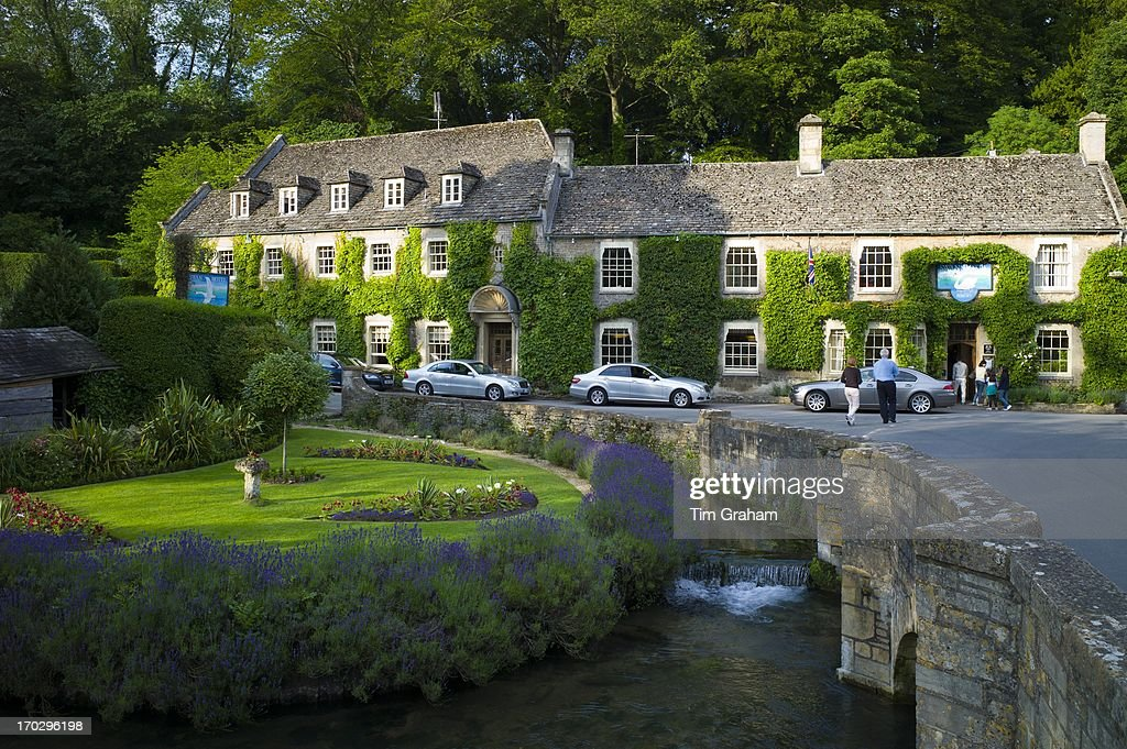 Swan Hotel And River Coln At Bibury In The Cotswolds Uk L To