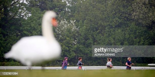 Swan is seen in the foreground as competitors take part in the non socially-distanced Reunion 5K running race, one of the pilot events in the...