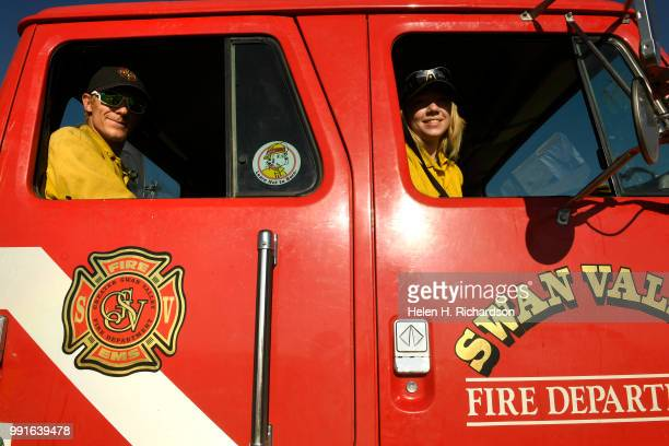Swan Valley firefighters MacKinnon Pruett left and Destri Vias right get ready to leave the spike camp to head out on the Spring Creek Fire on July 4...