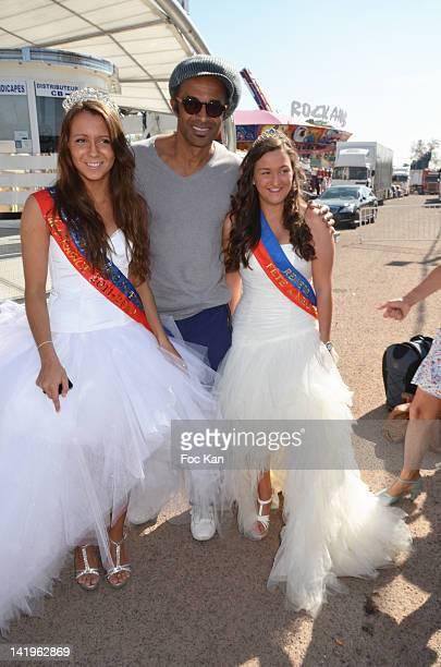 Swanny Lapaumerouzie 'Miss Foire du Trone 2012' Yannick Noah and Tiphaine Gratepanche 'Miss Fete Neuneu 2012' attend the Yannick Noah Gives Press...